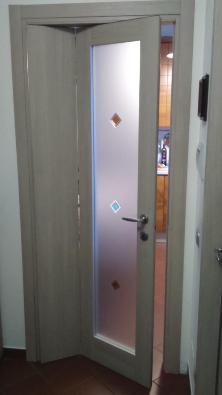 Centro serramenti milani serramenti malnate porte interne - Porta a libro bianca ...